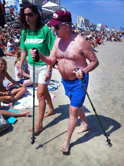 A man acting like a pterosaur on the beach