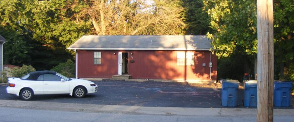 Figure 1. The simple house with the blacktop front yard. The mural is hard to see from this angle.