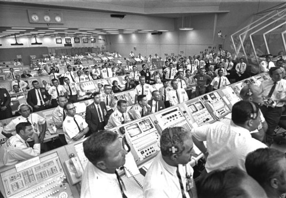 Figure 2. Mission control, Houston, Texas. These humans were only a small part of a huge cooperative effort that sent men to the moon and back.
